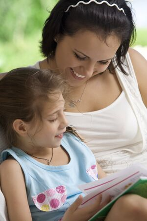 portrait of happy mother with daughter  having good time in summer environment photo