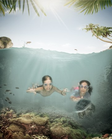 scuba goggles: Portrait of little kids having good time in summer environment Stock Photo