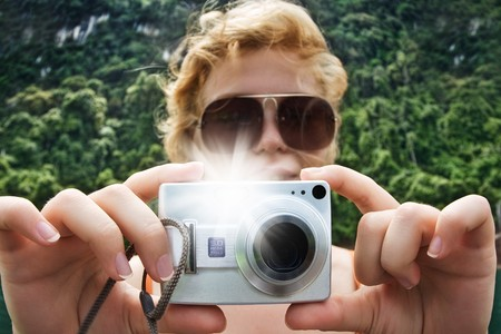 Portrait of young nice woman taking photo in summer environment photo