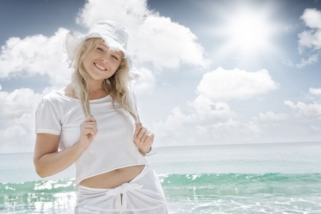 sun hat: Portrait of nice young woman  having good time on tropical beach Stock Photo