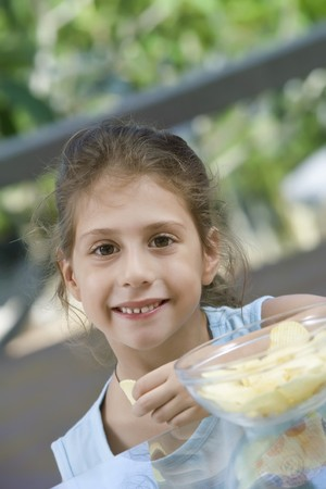 portrait of nice little girl in summer environment photo