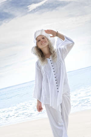 enjoyment: Portrait of nice young woman  having good time on tropical beach Stock Photo