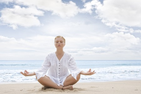 yoga meditation: Portrait of young woman practicing yoga in summer environment