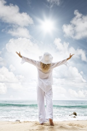 spiritual light: Portrait of nice young woman  having good time on tropical beach Stock Photo