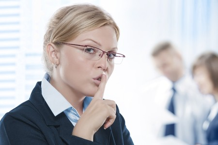 Portrait of young beautiful woman in office environment