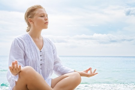 Portrait of young woman practicing yoga in summer environment Stock Photo - 8074445
