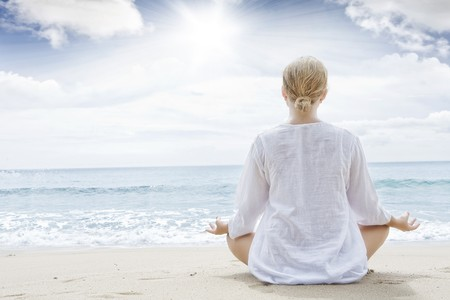 lotus pose: Portrait of young woman practicing yoga in summer environment