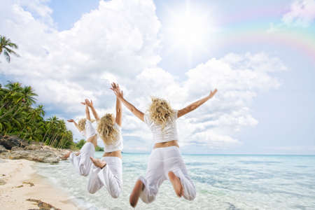 Portrait of nice young women  having good time on tropical beach photo