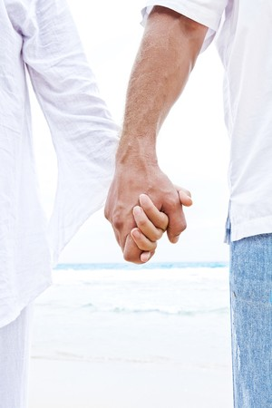 homosexual couple: Close up view of two hands holding each other