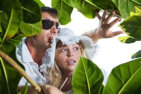 voyeur: Portrait of young nice couple having good time inj tropic environment