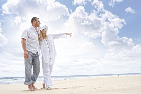 Portrait of young nice couple having good time on the beach photo