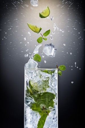 cool mint: Close up view of mojito cocktail on black background
