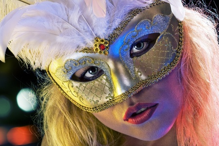fandango: Close up portrait of young woman wearing mask on color back Stock Photo