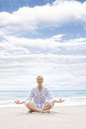 Portrait of young woman practicing yoga in summer environment Stock Photo - 8377495