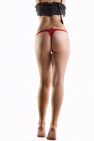striptease women: Close up view of nice smooth woman's legs on white back Stock Photo