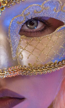 Close up view of young woman wearing mask photo