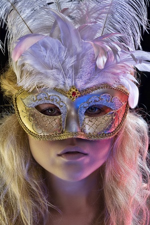 Close up portrait of young woman wearing mask on color back photo