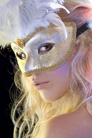 Close up portrait of young woman wearing mask on color back Stock Photo - 8378079