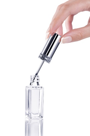 nail brush: Close up view of nail polishing on white back Stock Photo