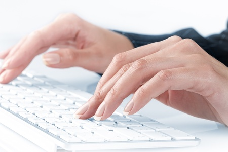 close up  view of female hands touching computer keyboard photo
