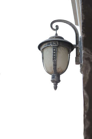 close up view of  antique style street lantern on white back   photo