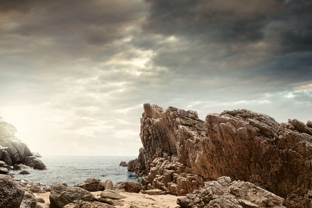 rock: panoramic view of  nice colorful  huge cliff  and sea on the back Stock Photo