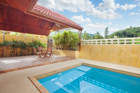 panoramic view of nice summer house patio with swimming pool photo