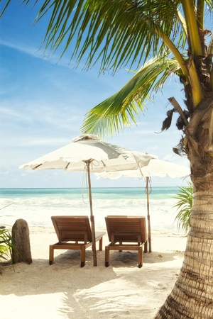 seaview: view of two chairs and  white umbrella on the beach