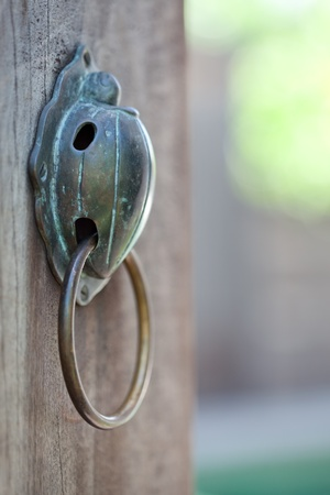 castings: close up view of nice brass handle on color back Stock Photo
