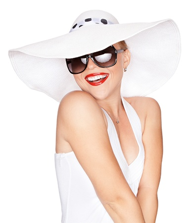 Portret van jonge mooie vrouw in de hoed en zonnebril Stockfoto