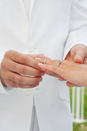 close up view of humans hands wedding photo