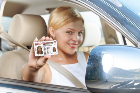 license: portrait of young beautiful woman sitting in the car