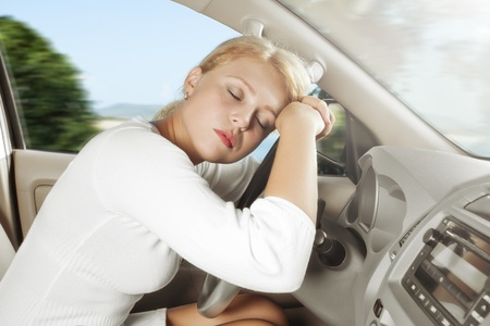 auto leasing: portrait of young beautiful woman sitting in the car