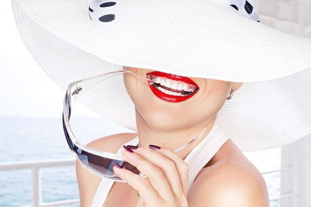 portrait of young beautiful woman in hat and sunglasses Stock Photo - 12409302