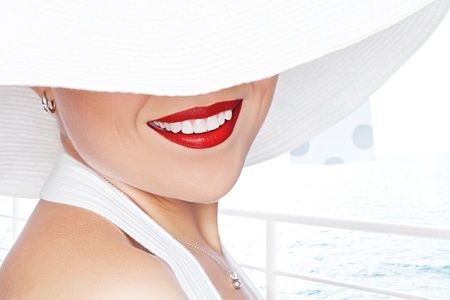 High key portrait of young beautiful woman  in white hat  Stock Photo - 13664364