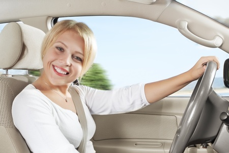motor vehicle: portrait of young beautiful woman sitting in the car