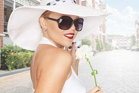 girl teeth: portrait of young beautiful woman in hat and sunglasses