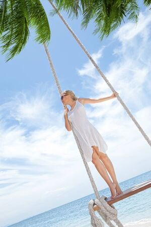plage: View of nice tropical  beach  with  girl on swing  Stock Photo