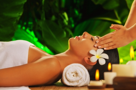 relax massage: portrait of young beautiful woman in spa environment