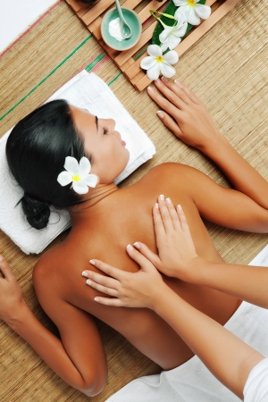 body massage: portrait of young beautiful woman  back  in spa environment