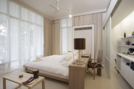 Panoramic view of nice stylish modern bedroom