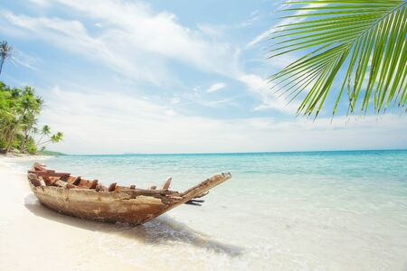 shallop: View of nice tropical  beach  with old boat