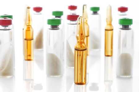 listening device: Close up view of different  ampoules  on white back