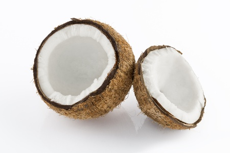 coconut milk: Close up view of nice fresh coconut ion white back