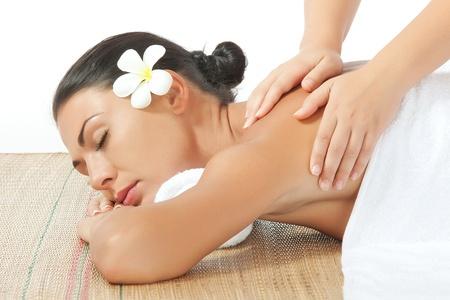 sensual massage: portrait of young beautiful woman on white back