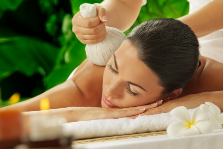 cosmetics bag: portrait of young beautiful woman in spa environment