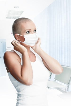 Portrait of nice young woman in surgery mask on white back Stock Photo - 20057010