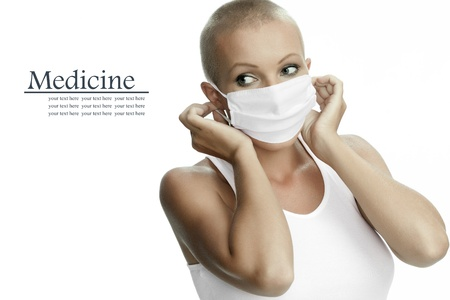 Portrait of nice young woman in surgery mask on white back Stock Photo - 20057030