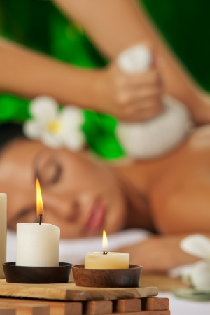 portrait of young beautiful woman in spa environment  focused on candles  Stock Photo - 20056991
