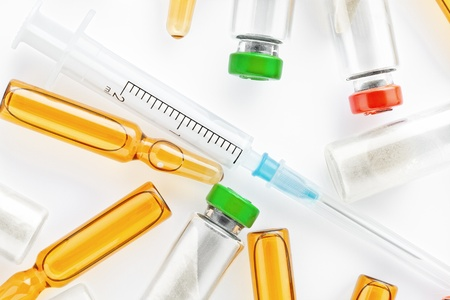 ampoules: Close up view of syringe and different  ampoules  on white back